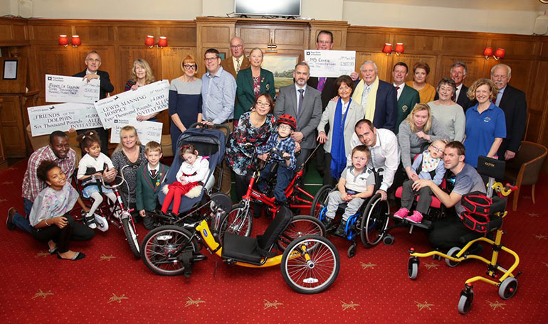 Peter Alliss presented disabled youngsters with mobility aids (picture is of last year's presentation)