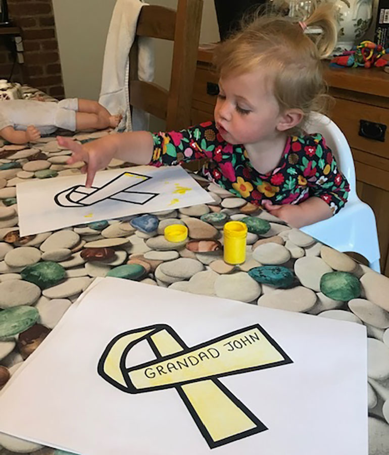 Ivy O' Hare, 2, creating yellow ribbons for loved ones