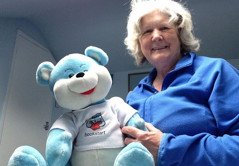 Mary Howell, Library Assistant, with Bookstart Bear