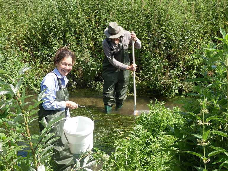 Riverfly volunteers surveying river in Dorset by Angus Menzies