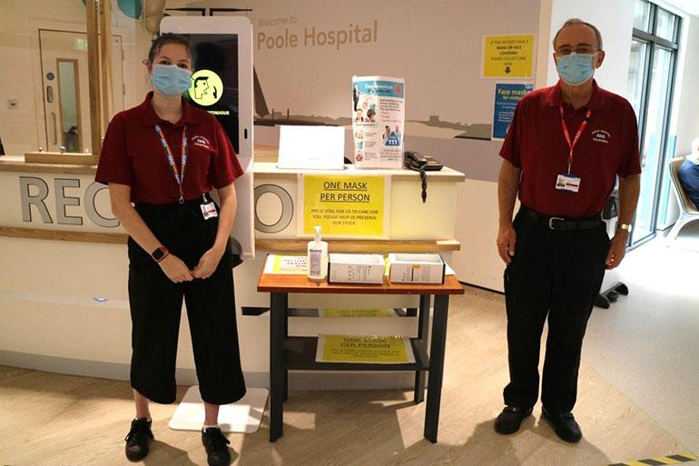 Two volunteers at Poole Hospital