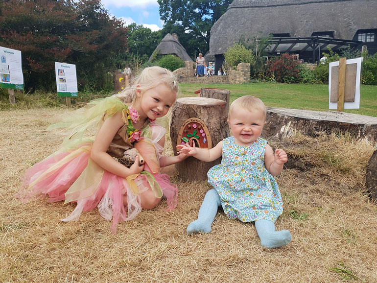 Autumn Cross takes a little visitor to see her fairy door
