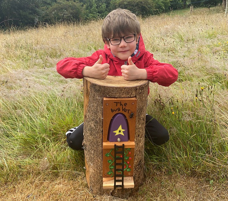 Finlay Guppy gives his fairy door the thumbs up