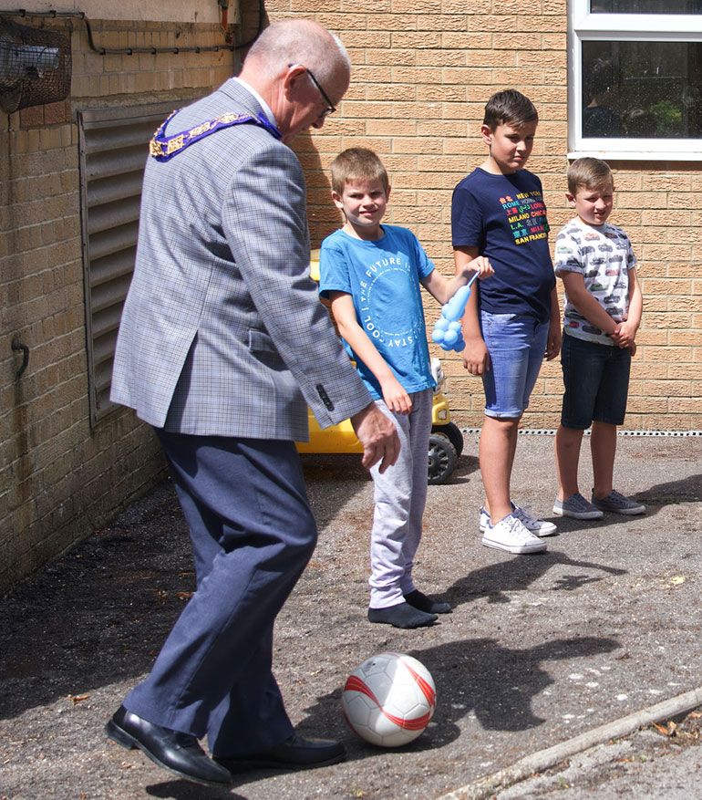 The Dorset Freemasons enjoy a kick about with children supported by Coping with CHAOS