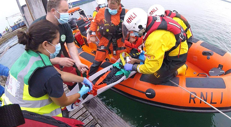 The casualty is taken to safety on a stretcher