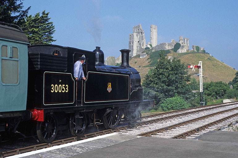 Swanage Railway passenger train passes the ruins of Corfe Castle ©Andrew PM Wright