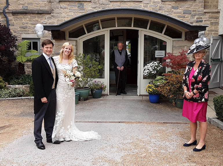 Reverend Jim Cocke, with granddaughter Lucy, her groom Nick Dawnay and mother of the bride Fiona Boggis