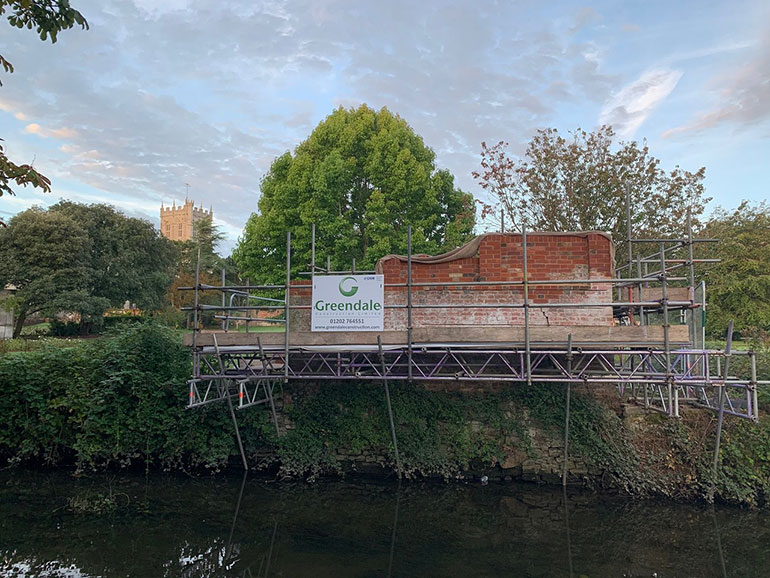 Christchurch Priory's wall restoration in progress