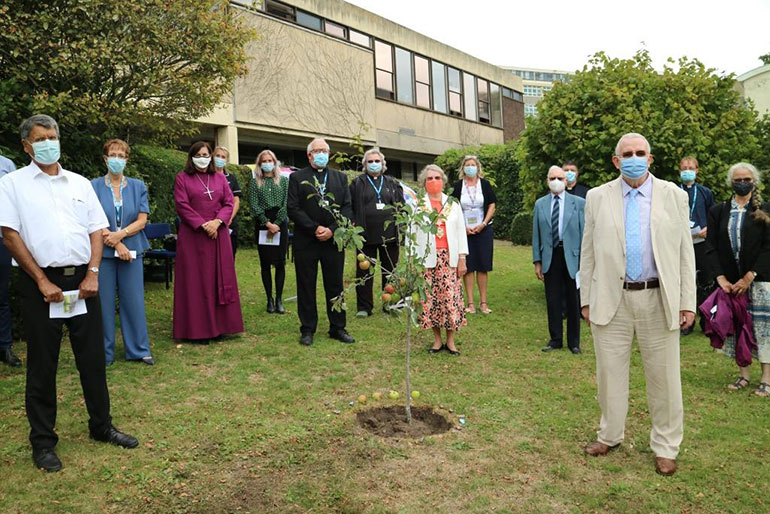 Guests at the tree planting event with Greg Wain, far right