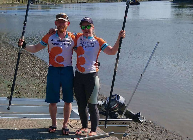 Adam and Helen on their paddle board challenge