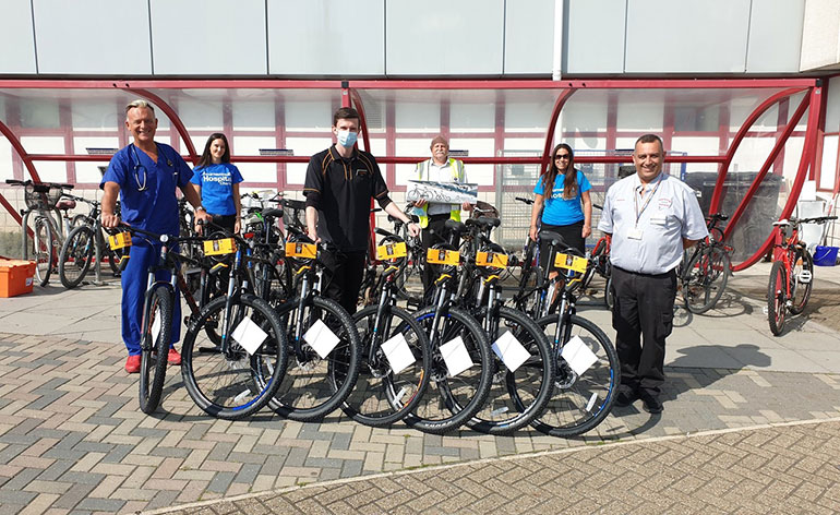 Consultant Physician Damian Jenkinson, left, was the first staff member to receive his bike