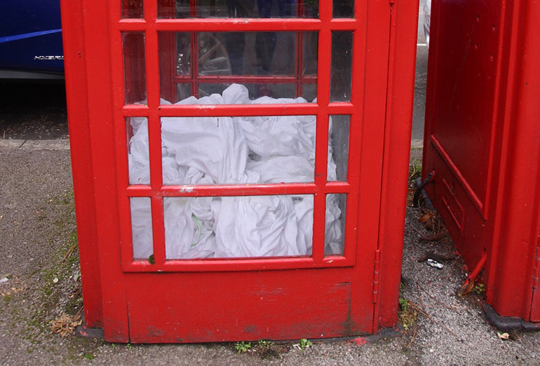 Bedding left in a telephone box