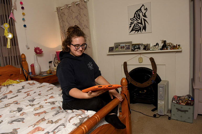 Florrie uses her tablet in her room at Minstead Lodge, the residential home for people with learning disabilities