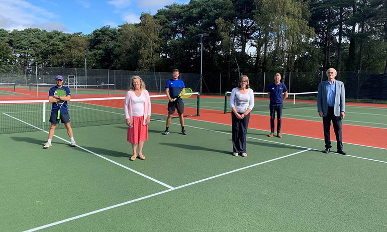 Group photo at the newly refurbished tennis courts in Ferndown