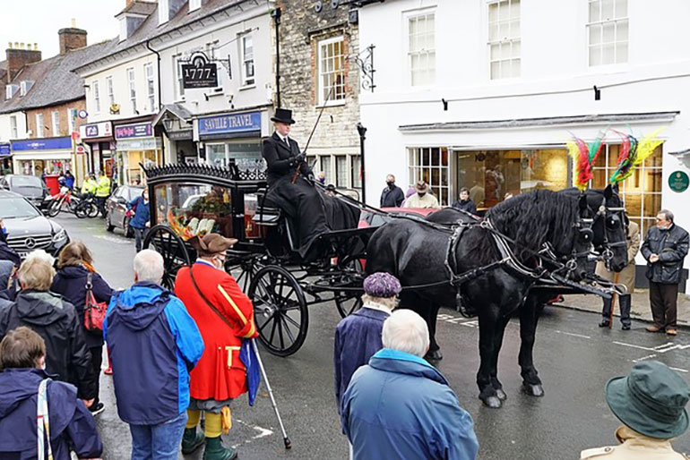 The horse drawn hearse stops outside the Museum of East Dorset (Priest's House) in Wimborne © Tom Scrase 2020