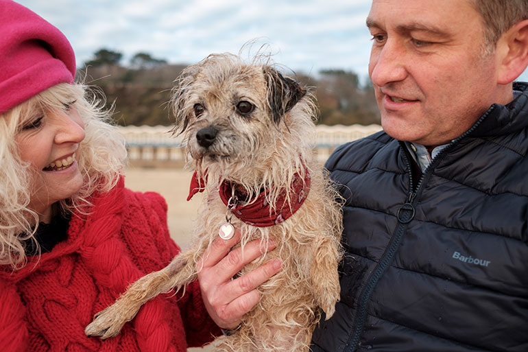 Sam and Chris Devlin with 11-year-old border terrier, Kipster