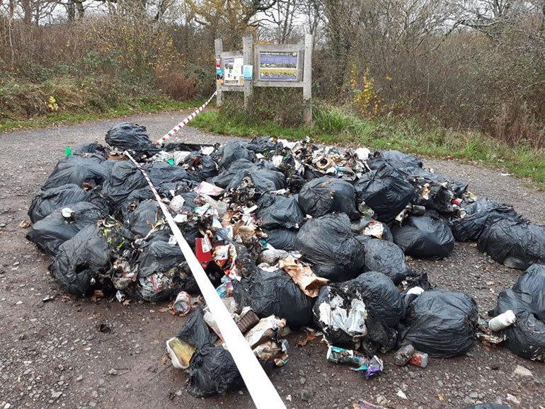 Fly-tipping at Powerstock Common nature reserve. Photo by Lucy Ferris