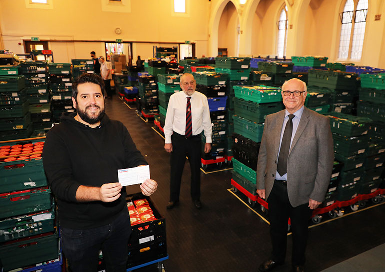 John Saborido, office manager at Bournemouth Food Bank, with Tony Drake and Paul Poyntz from Knole Lodge of Freemasons