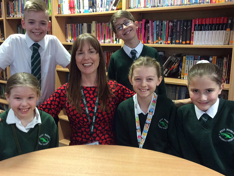 Deborah Craddock, headteacher of West Moors Middle School, with some of her students