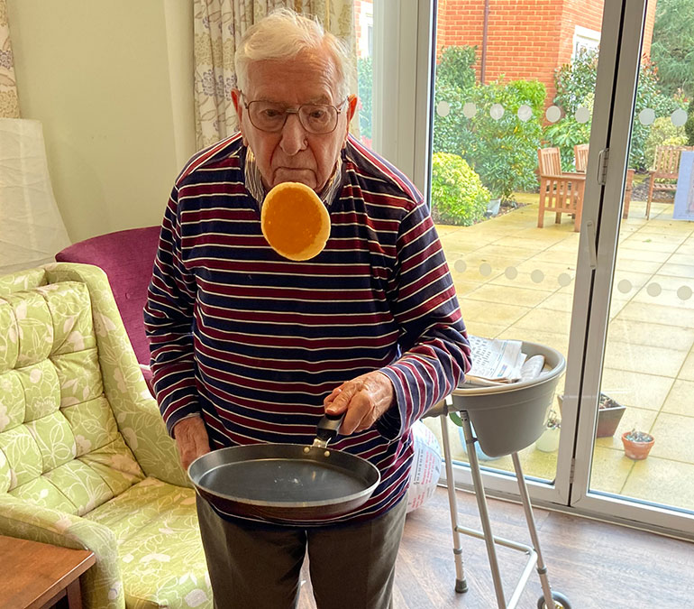 Power of concentration: Andre Mauger, a resident of Great Oaks flips a pancake