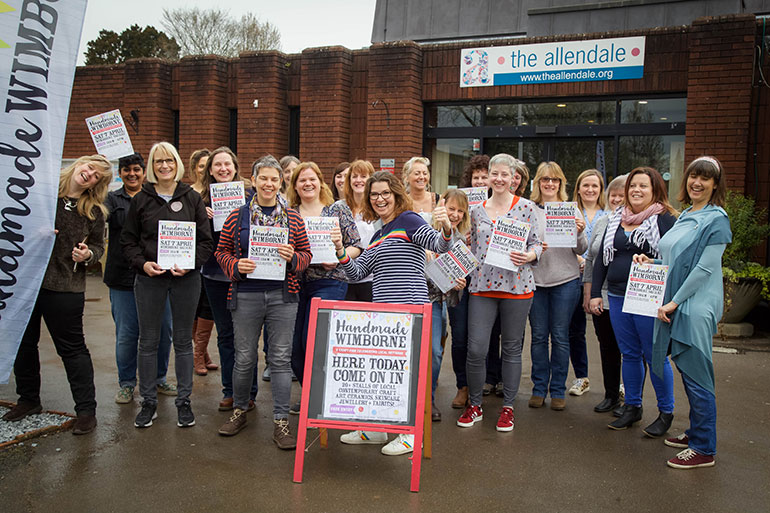 The Handmade Wimborne sellers from the 2018 Discover Wimborne Festival. Kyleigh Orlebar in the centre is now a BID director