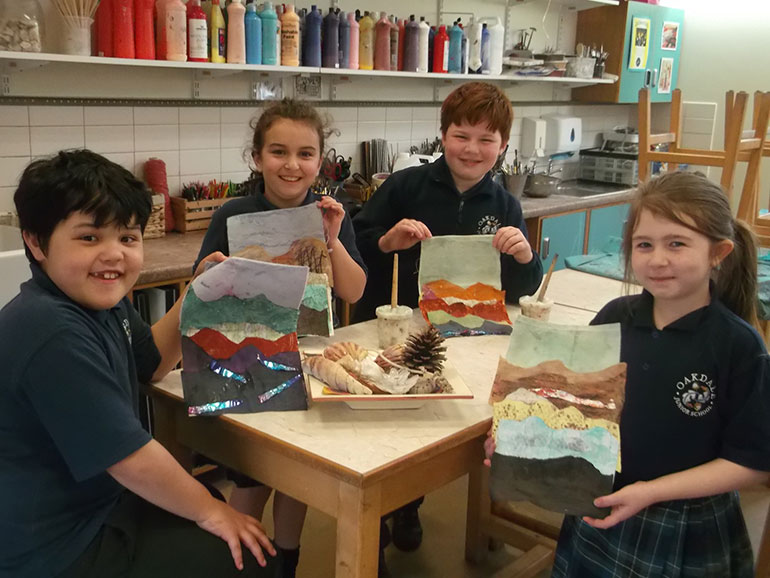 Pupils (l-r) James, Lily, Christina, and Leo with their artworks