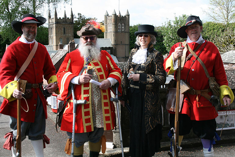 Chris Brown and Jacquie Hall with two members of the Wimborne Militia