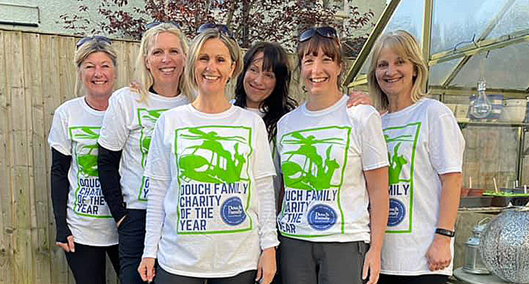 Emma Regan, centre, with her team of walkers that completed 26 miles