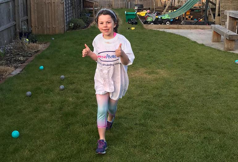 Amelie Mortimer running laps around the garden