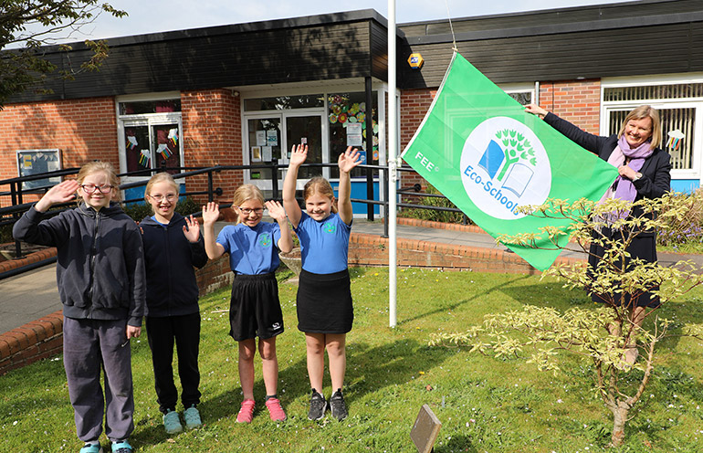 The school's eco warriors with the flag