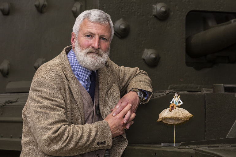 Tank Museum curator David Willey with Little Audrey on a Cromwell tank