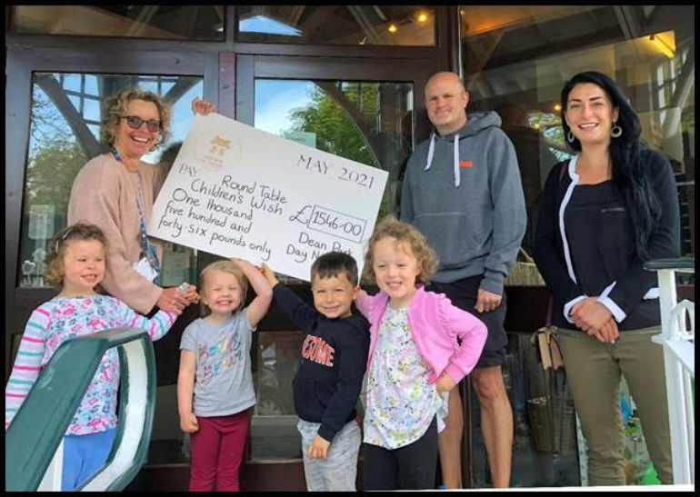 Bex Ballington and youngsters from Dean Park Day Nursery hand over the money they raised for Round Table Children's Wish. Also pictured are Rich Cooper and RTCW fundraising officer Clare Kyrillou, right