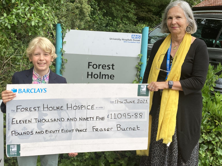 Fraser Burnet presents Forest Holme Hospice counsellor Dania Moussalli with the cheque