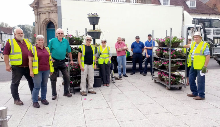 A small team of Wimborne in Bloom volunteers plus Wimborne Minster Town Council groundsmen, distributed and hung the 150 baskets in just over four hours. Photo by John Allen