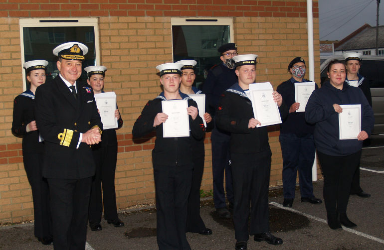 Rear Admiral Lambert congratulates the Poole Sea Cadets who had attained a Duke of Edinburgh Award © Bruce Grant