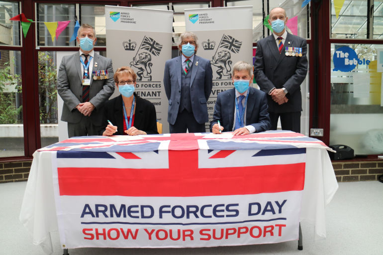 L-R: Andy Whittingham, UHD armed forces support group; Debbie Fleming, UHD chief executive; Kevin Moore, Dorset Armed Forces Covenant programme coordinator; David Moss, UHD chairman; Dr Shane McCabe, consultant anaesthetist and clinical champion, UHD armed forces support group