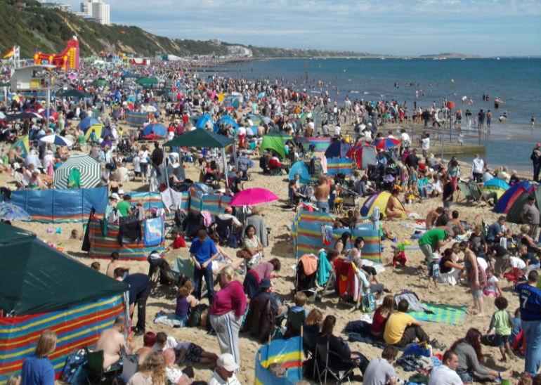 Previous bank holiday crowds enjoying Bournemouth beach
