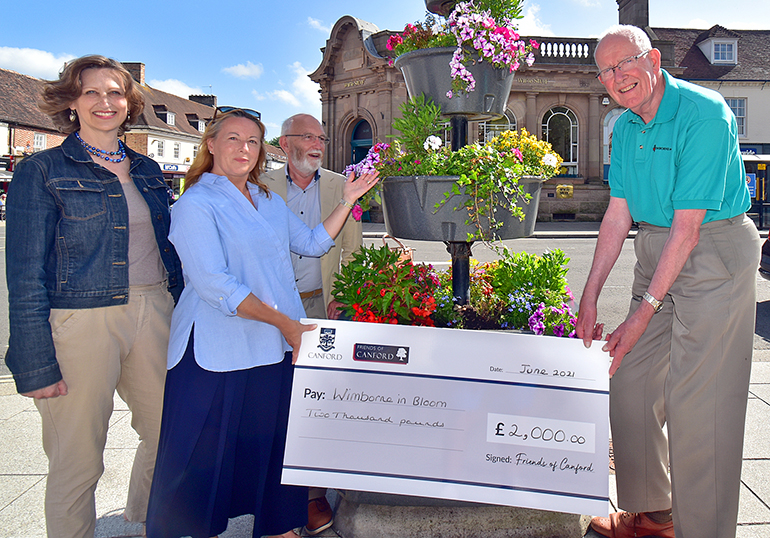 The Friends of Canford School (front) Tiffany Fleming (chairman), Perianne Graham (vice chairman) and Mike Durham (treasurer) hand over the cheque toAnthony Oliver. Photo by Tom Scrase