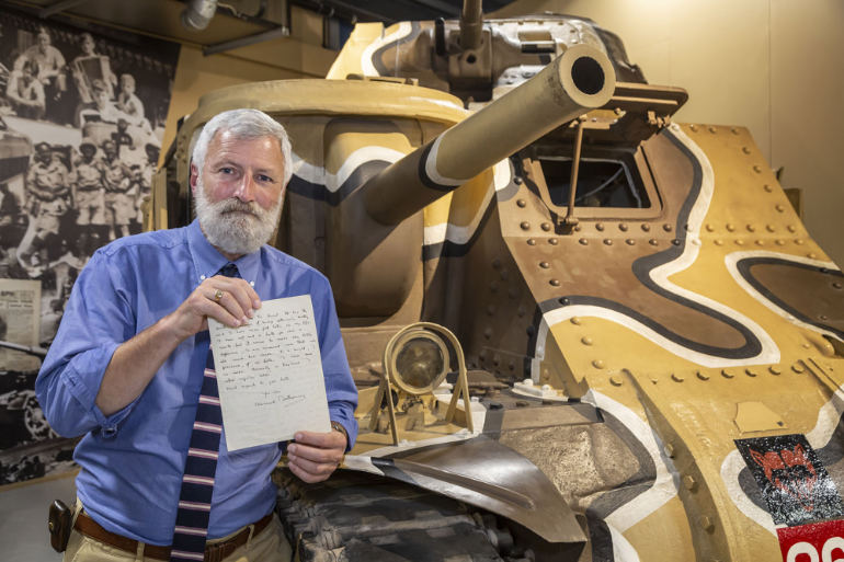 David Willey, curator of the Tank Museum with the letter by Bernard Montgomery