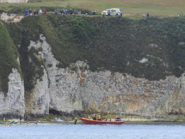 Poole lifeboat goes to the aid of a kayaker and his son at the foot of Old Harry rocks