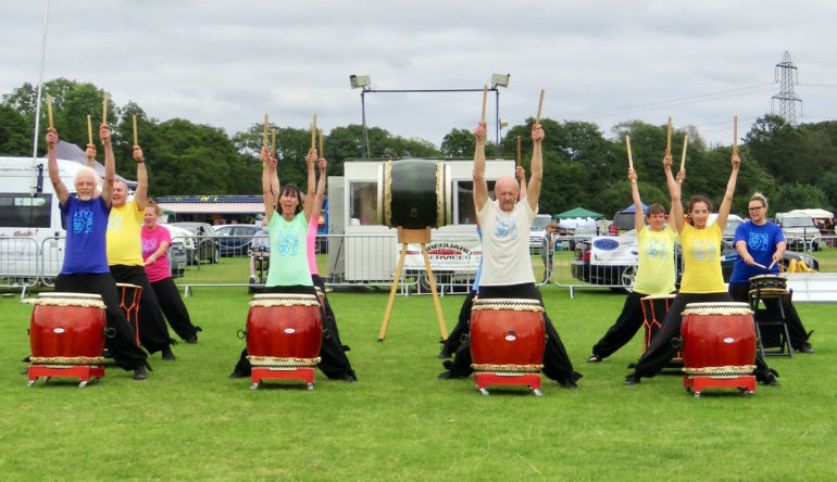 Tano Taiko Drummers from Newton Abbot in Devon entertain at Potterne Park, Verwood