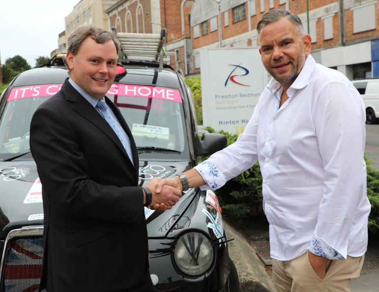 Adrian Falck, managing partner of Preston Redman, with Steve Wells of the BC Club