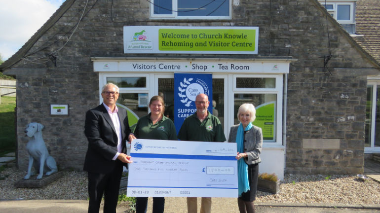 Cheque handed over by Care South management to Margaret Green Animal Rescue at Church Knowle