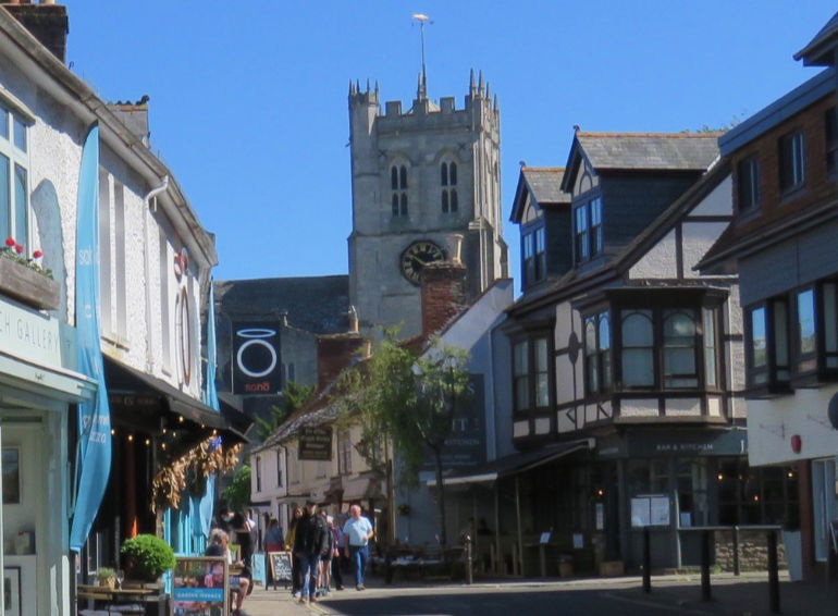 Could Bournemouth, Christchurch and Poole bid for city status? Pictured is a view of Christchurch Priory from the town centre