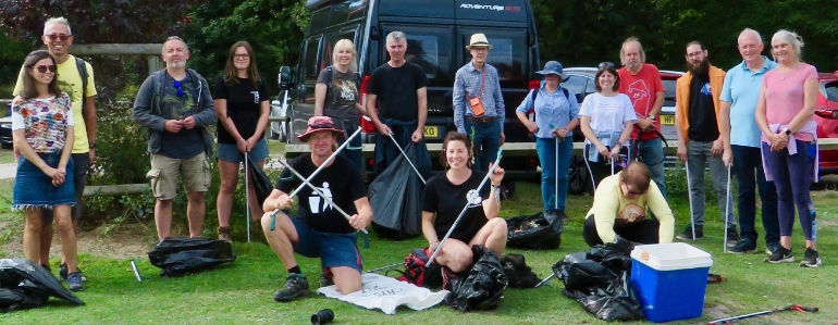Roy Beal (front left) with volunteers after Clean Jurassic Coast's latest Dorset litter pick. The cool box was found on Studland beach along with 11 kilos of other plastic rubbish and litter