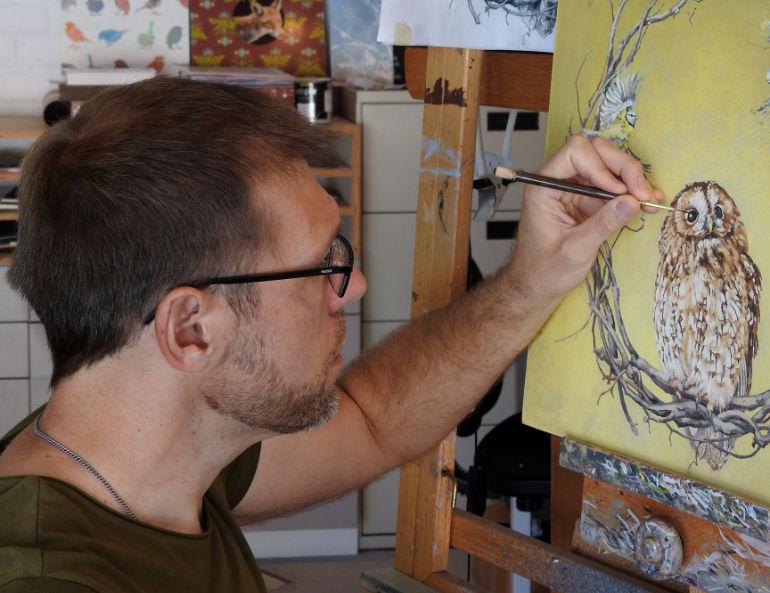 Arizona-based artist Andrew Denman working in his studio