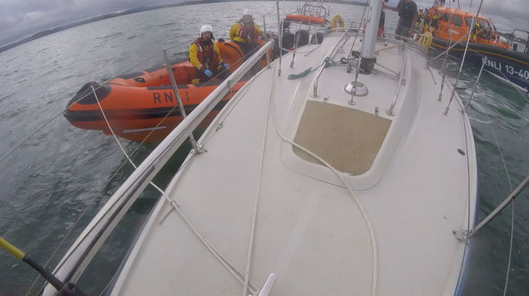 Handover of tow from Swanage to Poole lifeboat