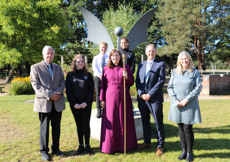 (l-r) John Spatchet, teacher from 1971-2009 and chairman of governors, pupil, Bishop Karen Gorham, Ron Jenkinson, headteacher, Rev Suzanne Pattle, with two more pupils behind