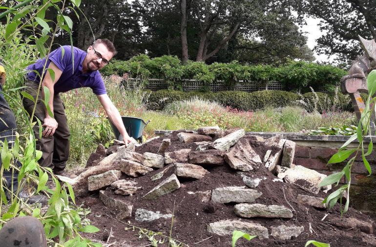 Volunteer building a newt ramp