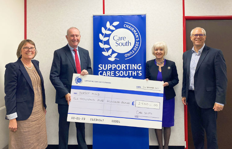 Cheque presented to Dorset Mind by Care South's chairman, Jane Stichbury, and chief executive, Simon Bird
